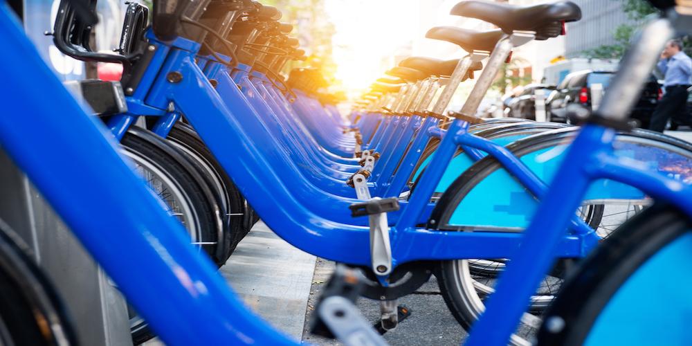 Bicycle rental service spot on city street. Public transportation concept.